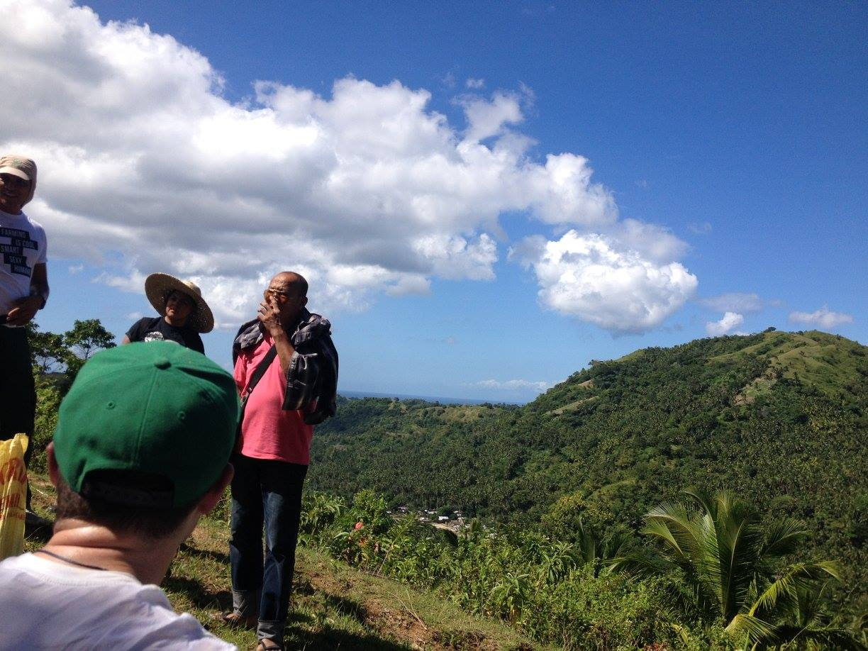 Atop Duyay Hill. New Zealand social entrepreneurs and AGREA staff are led by Duyay farming community to the location for cacao seedlings planting. Photo: Rachel Espejo